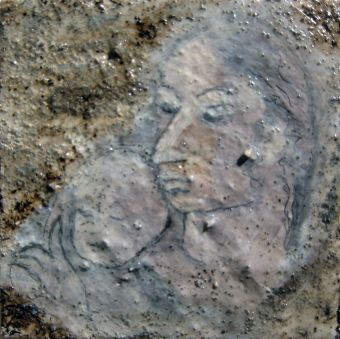paper sketch of mother and child in stucco wall