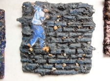 Climbing Down, composed bricks, carved, rocks, paper, paint, pen